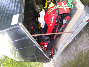 2 snowmobiles and enclosed trailer