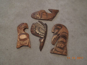 Native carvings and framed pictures