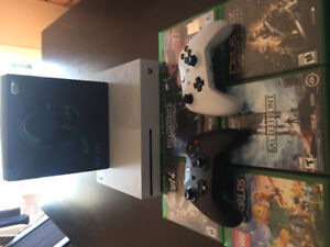 Xbox one s with 6 games two remotes and headset