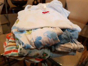 7 x 12-18 boys sleepers and 1 diaper shirt