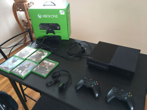 Xbox one, 2 controllers, 5 games and xbox small headset.