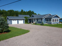 CUSTOM BUILT EXECUTIVE HOME ON FRENCH RIVER!!