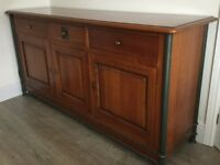 Solid wood sideboard with metal edging.