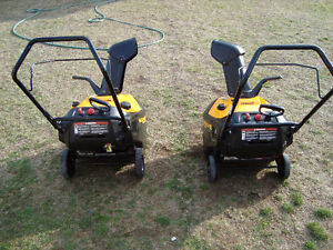 PAIR OF POULAN GAS 21 INCH SNOW THROWERS