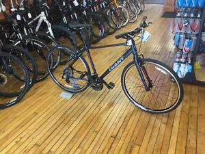 Giant touring bike with saddle bags and racks