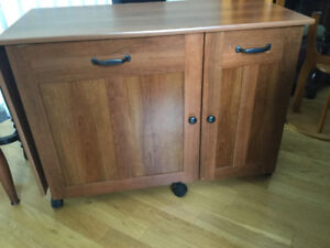 Sewing machine cabinet with a drop leaf,