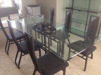 Glass dining table and hutch