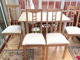 Wood dining table with 4 chairs, good condition