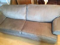 Matching taupe microfiber couch and loveseat