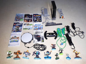 Wii Console, games, nanchuks and Skylander swap force set