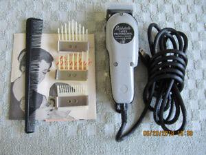 Tondeuse (rasoir) à cheveux  avec ses accessoires et brochure.