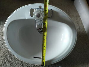White enamel sink - like new. Faucet included