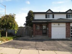 UPDATED END UNIT TOWNHOUSE! FENCED YARD! FINISHED BASEMENT!