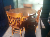Solid oak single pedestal dining table