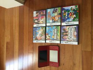 Nintendo DS XL with charger and assorted games