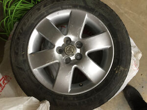 4 used rims and tires(bolt pattern 5x100)