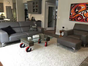 Grey leather sofa, armchair and ottoman