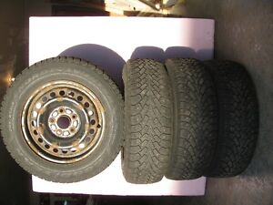 4 GOODYEAR NORDIC STUDDED WINTER TIRES AND RIMS 205/65R15