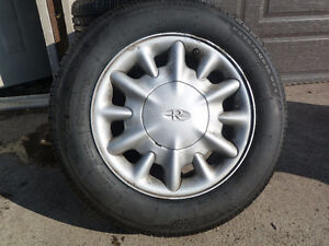 4  225/60R16 All Season Tire mounted on GMC alloy rims.