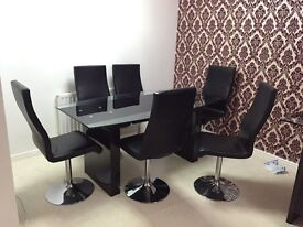 Glass Dining table with 6 chairs (delivery available)