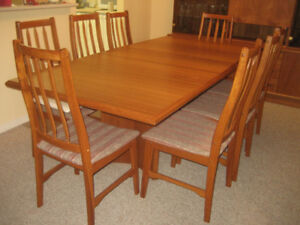 BEAUTIFUL SOLID TEAK DINING ROOM SET FOR SALE. WE ARE DOWNSIZING
