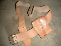 tan leather belt with small wallet attached