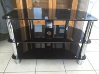 Black / chrome shinny glass tv stand Can deliver.