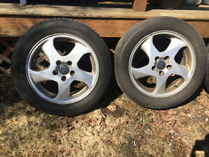 """Set of four 16"""" Volvo rims and tires 205/55/16"""