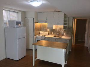 $1000 util incl Lovely new 1BR + Den