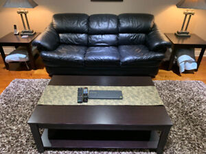 $125 coffee table set with two end tables. Good condition.