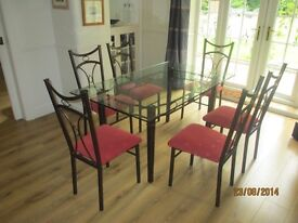 Glass dining table and up to 8 chairs