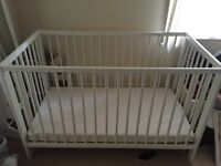 White cot with mattress, bedding, mobile and light