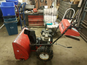 "28"" Snow blower with electric start and tire chains"
