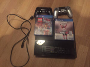 PS4 500GB 2 Controllers 2 Games 1 Blueray remote