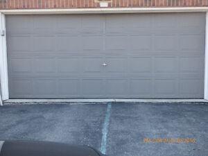 In using steel double garage door (whole set) 16x7 ft LAST SALE!