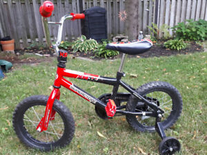 Almost brand new kid's bike with training wheels $30.