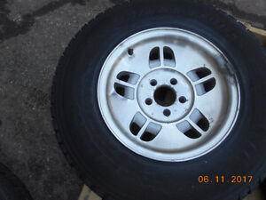 2 set of tires with aluminum rim off a mazda truck