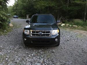 2009 Ford Escape Xlt comme neuf ou echange +argent!!
