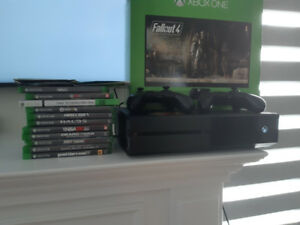 Xbox one 1tb W/ 17 games and 2 controller