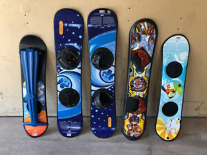 Kids snowboards, wagon, baseball gloves, stool and skateboards