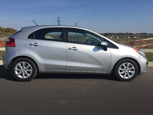 2014 Kia Rio GDI hatchback with nearly-new set of winter tires!