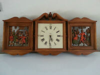 interesting older clock with parlour scenes