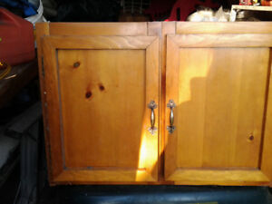 UPPER CABINET WITH STAINED PINE DOOR FRONTS. GREAT FOR BASEMENT