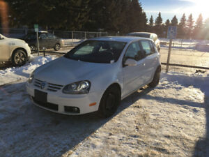 2009 VW rabbit. With studded winter tires and summer VWRims