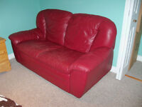 Burgundy reclining couch and love seat. Leather, made in Italy