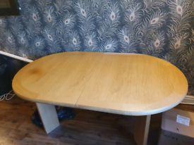 "Wooden Extendable Dining Table - 69"" x 41"". Extends upto 108"""