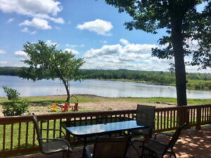 Gorgeous Beachfront Cottage Rental on Grand Lake in Whites Cove