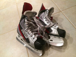 Hockey skates and Wee Play Skate Trainer