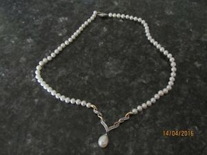 Genuine Real Pearl necklace with 23 small diamonds