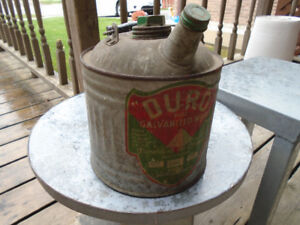 Duro Galvanized Old steel can for holding fluid.